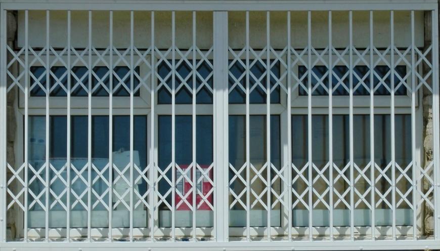rejas extensibles plegables - Instalación de rejas para puertas